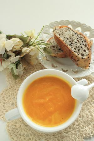 Pumpkin soup and sesame bread Stock Photo - 97110889