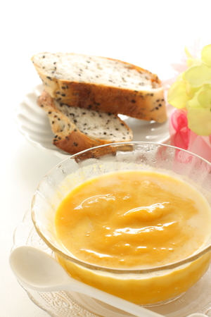 Pumpkin cold soup and bread Stock Photo