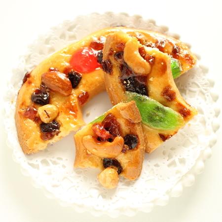 Christmas dried fruit and nut cookie Фото со стока