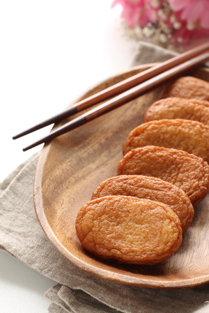Asian food, fish cake on wooden plate Stock Photo