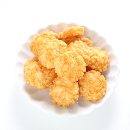 Japanese rice cracker, osenbei on dish with copy space Reklamní fotografie