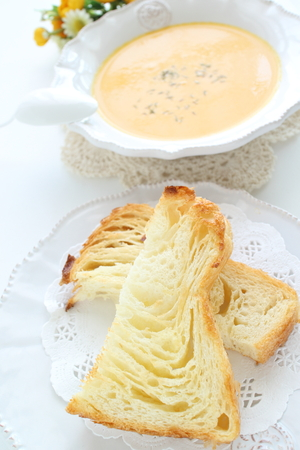 Toasted Danish bread on dish and pumpkin soup Stock Photo