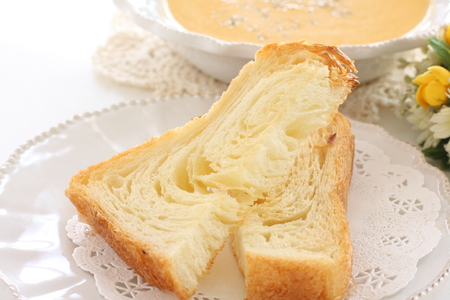 Toasted Danish bread on dish and pumpkin soup Imagens