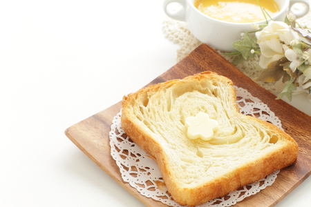 Sliced Danish bread and flower shaped butter Stock Photo