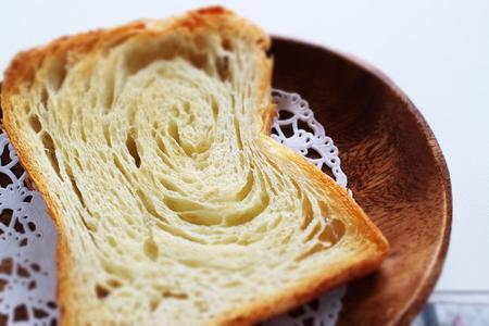 Sliced Danish bread on wooden plate