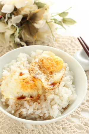Asian food, Pan fried quail egg and soy on rice 스톡 콘텐츠