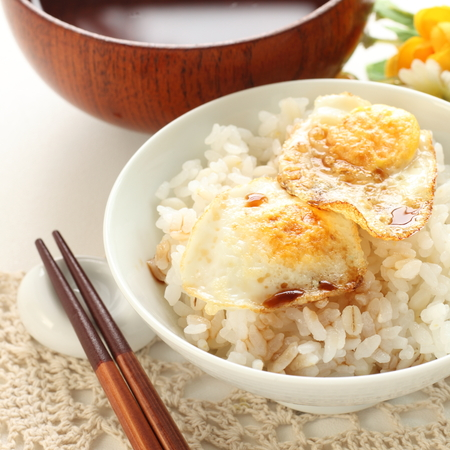 Asian food, Pan fried quail egg and soy on rice Stock Photo
