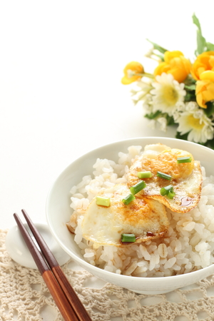 Asian food, Pan fried quail egg and soy on rice Stok Fotoğraf