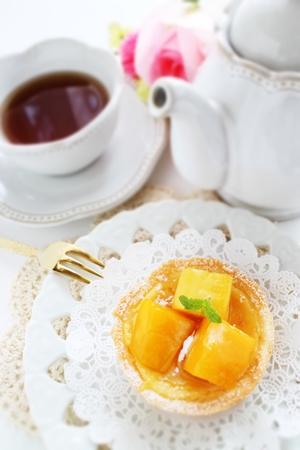 Mango tart and English tea Stock Photo