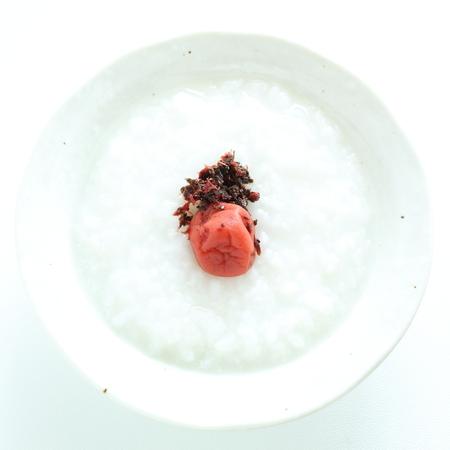 Japanese rice porridage served with plum