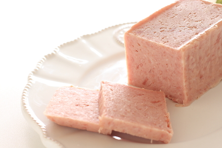 Sliced luncheon meat on dish Stock Photo
