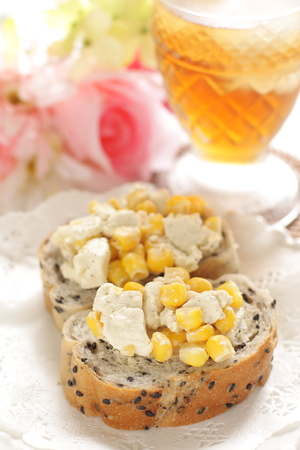Cream cheese and corn on french bread for open sandwich image