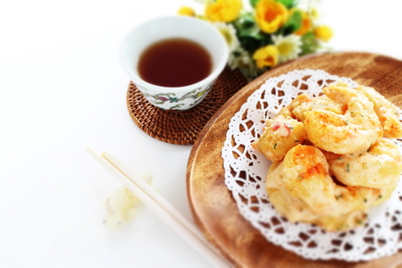 Chinese food, mayonnaise and deep fried prawn with tea