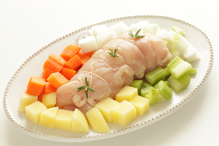 Homemade chicken roll and chopped vegetable Stock Photo