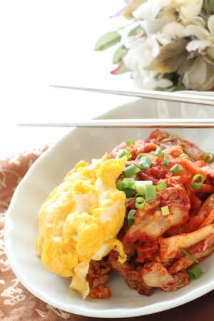 Korean food, kimchi and pork stir fried with scrambled egg