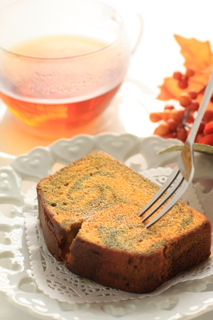 Autumn food, pumpkin cake and tea Stock Photo