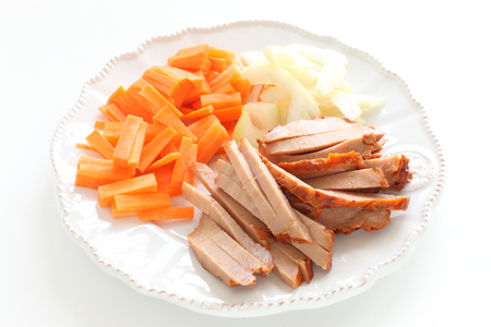 Chinese cooking, chopped roast pork and vegetable Stock Photo