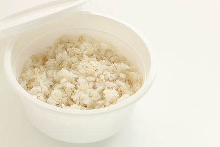 Japanese food, barley rice in plastic food container Archivio Fotografico - 104141544