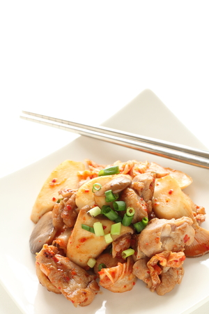 Korean food, chicken and kimchi stir fried with oyster mushroom