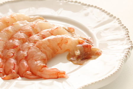 Peeled prawn on dish for cooking image