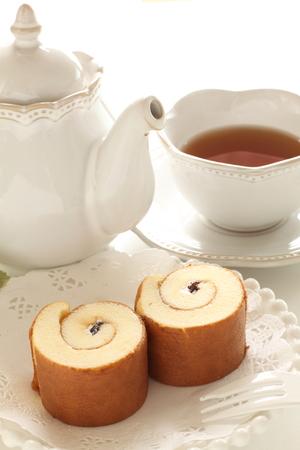 Homemade roll cake and tea Stock Photo