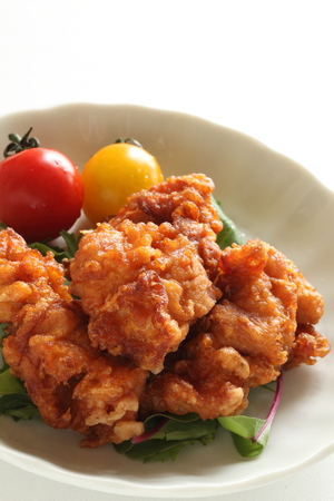 Asian food, deep fried Chicken with cherry tomato