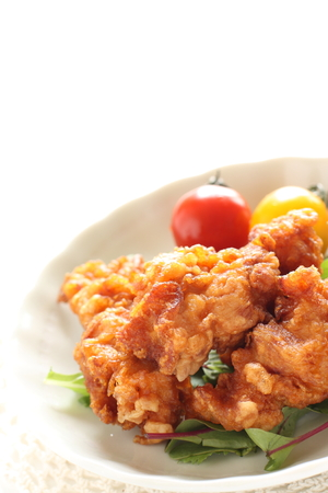 Fried chicken served with cherry tomato 写真素材