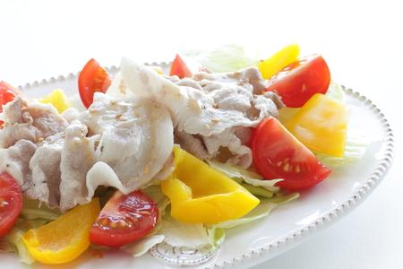 Japanes summer cuisine, boiled pork served with vegetable