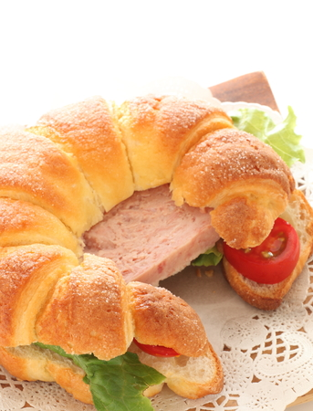 Luncheon meat and croissant sandwich