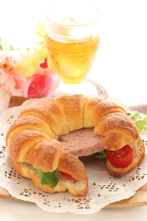 Luncheon meat and crossiant sandwich
