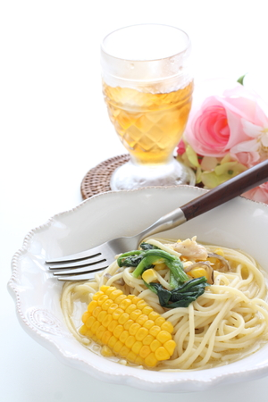 Italian cuisine, corn and spinach cream soup and spagetti
