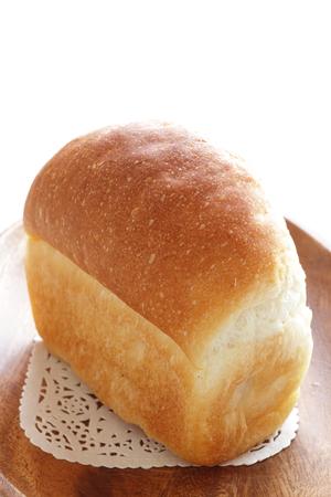 Homemade loaf of bread on wooden plate Banco de Imagens