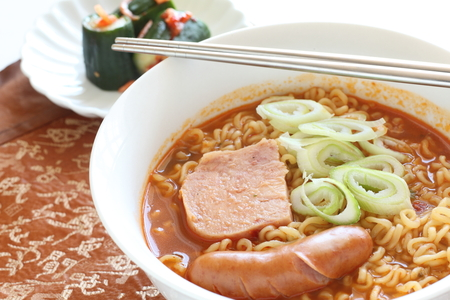 Asian food, luncheon meat and sausage on ramen noodles