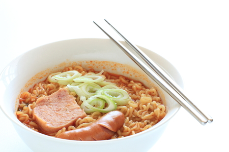 Korean food, luncheon meat and sauce on chili ramen noodles