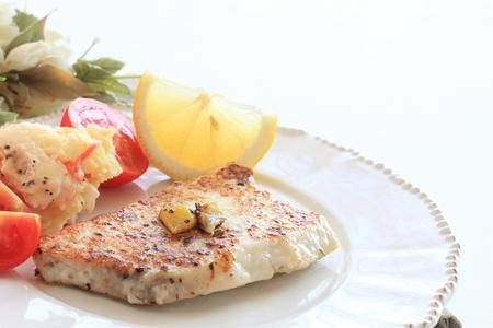 Sword fish fillet saute served with potato salad