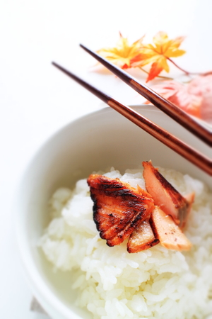 Japanese food, grilled salmon on rice for autumn food image