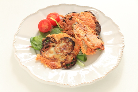 Cheese and lotus root pan fried served with baby leaf
