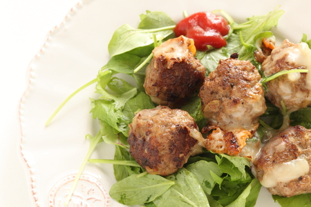 Homemade cheese meat ball on baby leaves salad