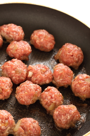 Meat ball on frying pan for cooking image