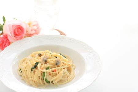 Glass of wine and clam spaghetti Archivio Fotografico - 114056936