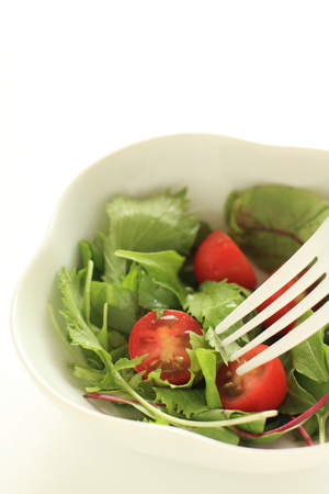Tomato and baby leaf salad