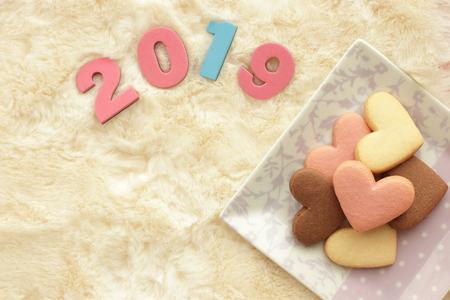 Number 2019 and heart shaped cookie Banco de Imagens