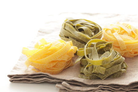 Fettuccine on linen cloth