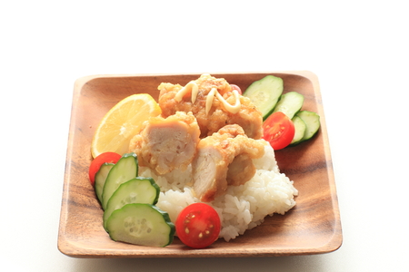 Fried chicken on rice served with tomato Stock Photo - 119057337