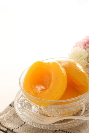Canned peach on glass bowl