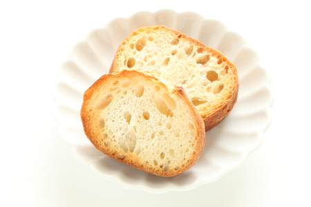 Toasted french bread on dish with copy space Stock fotó