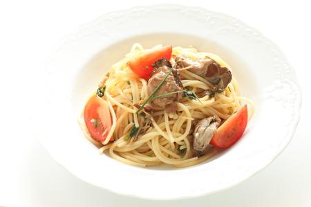 Smoked oyster and tomato spaghetti Archivio Fotografico - 122915732