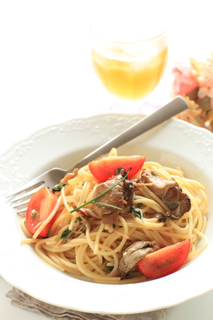 Italian food, smoked oyster and tomato spaghetti
