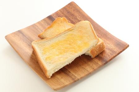 butter toast on wooden plate Stock fotó