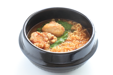 Homemde fried chicken and ramen noodles in korean clay pot